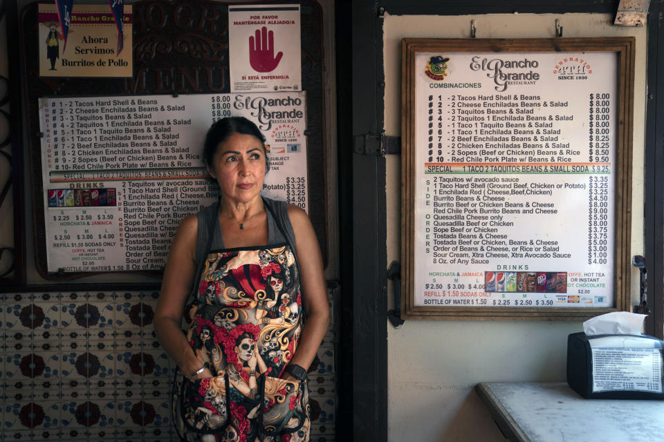 """Debbie Briano, a fourth-generation owner of El Rancho Grande Mexican restaurant on Olvera Street, stands for a photo in Los Angele, Tuesday, June 8, 2021. As Latinos in California have experienced disproportionately worse outcomes from COVID-19, so too has Olvera Street. """"As everyday goes by, I feel better and better,"""" said Briano. """"I'm hoping that once we open up next week, things are going to get back to normal, not really quick obviously, but it will. It takes time."""" (AP Photo/Jae C. Hong)"""