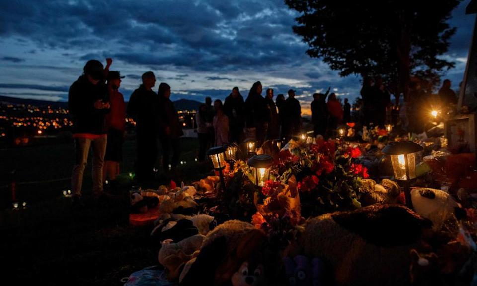 People gather outside a former Indigenous school near Kamloops in British Columbia, where the remains of 215 children were found, earlier this month.