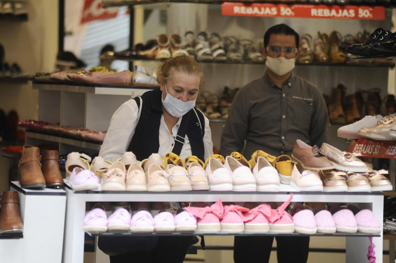 MEXICO CITY, MEXICO - JUNE 30, 2020: A costumer rises a shoe in a clothe store in downtown Mexico City; amid the new coronavirus pandemic has started to ease the COVID-19 lockdown restrictions to restart the economy, after several months of lockdown measures imposed in a bid to slow down the spread of the ongoing pandemic.. On June 30, 2020 In Mexico City, Mexico- PHOTOGRAPH BY Ricardo Castelan Cruz / Eyepix Group / Barcroft Studios / Future Publishing (Photo credit should read Ricardo Castelan Cruz / Eyepix Group/Barcroft Media via Getty Images)