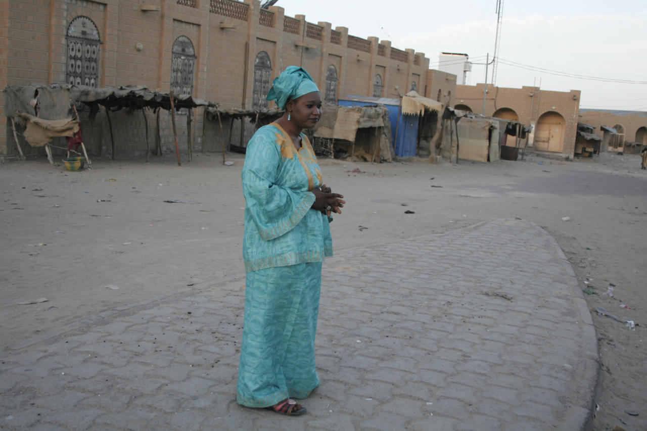 In this Monday, Feb. 4, 2013 photo, Salaka Djicke stands in the town square where she was publicly whipped after being caught having a relationship with a married man, in Timbuktu, Mali. Until they were chased out by the French last week, the Islamic extremists who controlled northern Mali since April applied a harsh brand of Shariah in the moderate Muslim region. Djicke was jailed and publicly flogged, and at least one other unmarried couple was executed by stoning. (AP Photo/Harouna Traore)