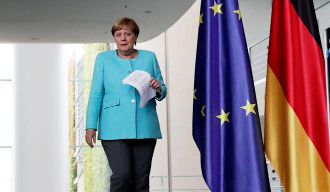 German Chancellor Angela Merkel arrives for a press conference at the Federal Chancellery in Berlin on Wednesday, following an EU summit on Belarus crisis held via video conference. Photo: AP via dpa