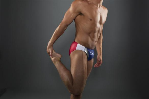 Diver Troy Dumais stretches while posing for a portrait during the 2012 U.S. Olympic Team Media Summit in Dallas, May 15, 2012.