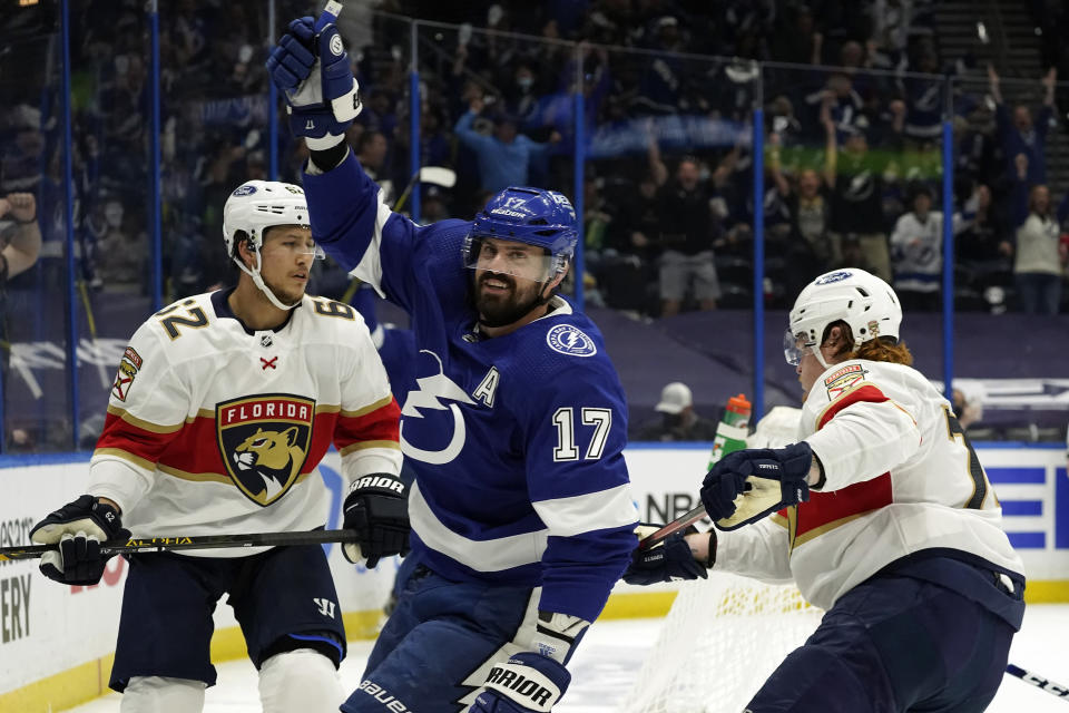 Tampa Bay Lightning left wing Alex Killorn (17) celebrates his goal in front of Florida Panthers defenseman Brandon Montour (62) during the second period in Game 4 of an NHL hockey Stanley Cup first-round playoff series Saturday, May 22, 2021, in Tampa, Fla. (AP Photo/Chris O'Meara)