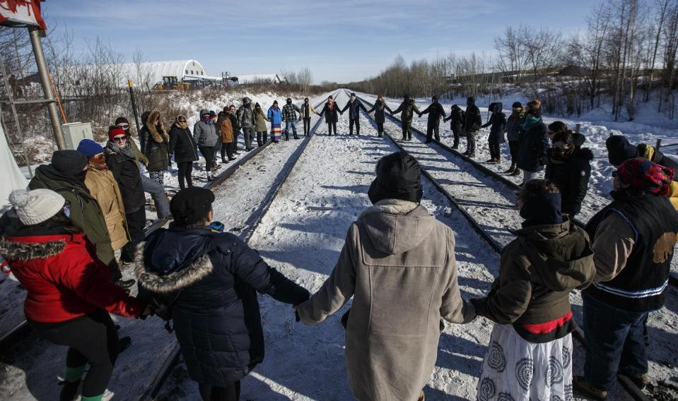 "<span class=""caption"">Supporters of the Wet'suwet'en hereditary chiefs perform a round dance at a blockade at a CN Rail line just west of Edmonton on Feb. 19, 2020. </span> <span class=""attribution""><span class=""source"">THE CANADIAN PRESS/Jason Franson</span></span>"