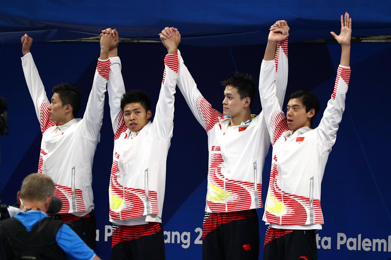 2018 Asian Games - Swimming - Men's 4 x 200m Freestyle Relay Final - GBK Aquatic Center, Jakarta, Indonesia - August 20, 2018  Silver medalists Wang Shun, Shang Keyuan, Yang Sun and Xinjie Ji of China during the medals ceremony  REUTERS/Athit Perawongmetha