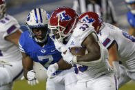 Louisiana Tech running back Justin Henderson (33) carries the ball as BYU defensive back George Udo (7) closes in for the tackle during the first half of an NCAA college football game Friday, Oct. 2, 2020, in Provo, Utah. (AP Photo/Rick Bowmer, Pool)