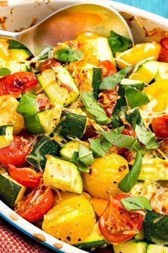 """<p>This easy side is the most delicious way to use up your summer vegetables.</p><p>Get the <a href=""""https://www.delish.com/uk/cooking/recipes/a28960969/zucchini-tomato-bake-recipe/"""" rel=""""nofollow noopener"""" target=""""_blank"""" data-ylk=""""slk:Courgette Tomato Bake"""" class=""""link rapid-noclick-resp"""">Courgette Tomato Bake</a> recipe.</p>"""
