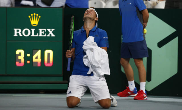 France's Lucas Pouille reacts after defeating Spain's Roberto Bautista Agut during the Davis Cup semifinals France against Spain, Friday, Sept.14, 2018 in Lille, northern France. (AP Photo/Michel Spingler)