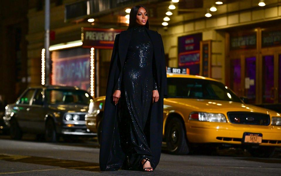 Naomi Campbell walks along 46th Street during the Michael Kors Fashion Show in Times Square on April 08, 2021 - GC Images