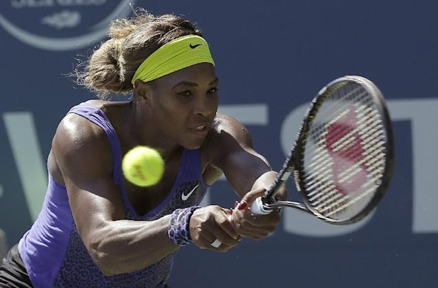 Serena Williams returns the ball to Andrea Petkovic, from Germany, during the second set of a semifinal in the Bank of the West Classic tennis tournament in Stanford, Calif., Saturday, Aug. 2, 2014. Williams won 7-5, 6-0. (AP Photo/Jeff Chiu)