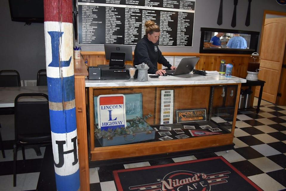 A post inside Niland's Cafe notes its location at the intersection of the historic Lincoln Highway and Jefferson Highway in Colo, Iowa.