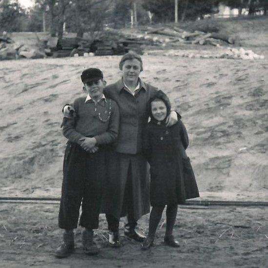 Female guard Johanna Langefeld with her son and another guard`s daughter