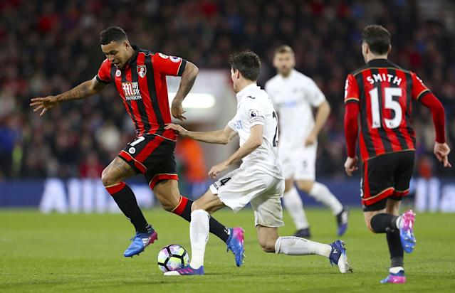 <p>AFC Bournemouth's Joshua King, left, and Swansea City's Jack Cork battle for the ball during the English Premier League soccer match at the Vitality Stadium </p>