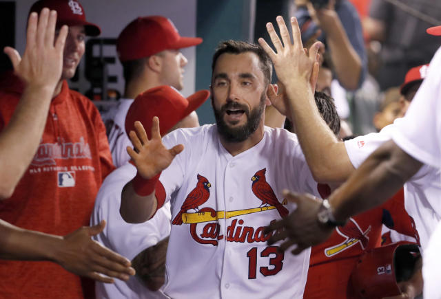 St. Louis Cardinals' Matt Carpenter is congratulated by teammates in the dugout after hitting a solo home run during the seventh inning of a baseball game against the Kansas City Royals Monday, May 21, 2018, in St. Louis. (AP Photo/Jeff Roberson)