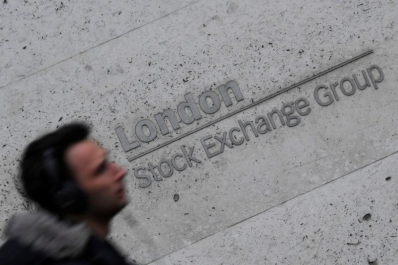 People walk past the London Stock Exchange Group offices in the City of London, Britain