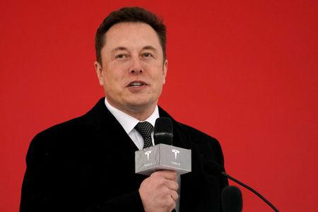 Elon Musk looks guilty of distracted driving