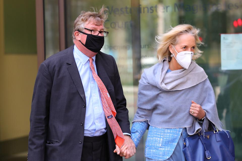 Hedge fund manager Crispin Odey leaving Westminster Magistrates' Court, London, with his wife Nichola Pease, where he was accused of assaulting a young investment banker in the late 1990s.