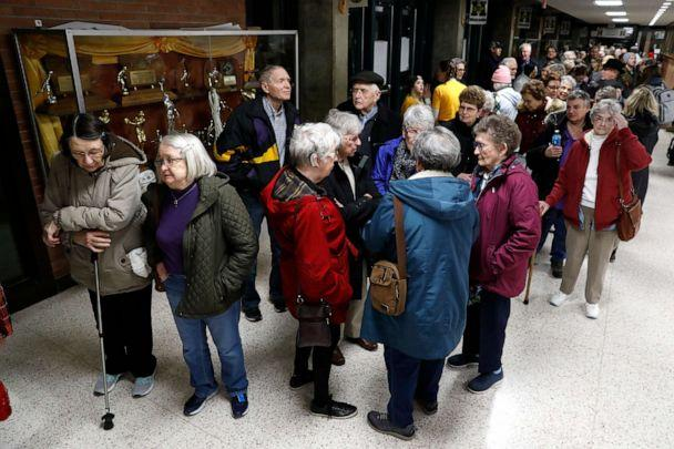 PHOTO: Local residents wait to enter an Iowa Democratic caucus at Hoover High School, Feb. 3, 2020, in Des Moines, Iowa. (Charlie Neibergall/AP)