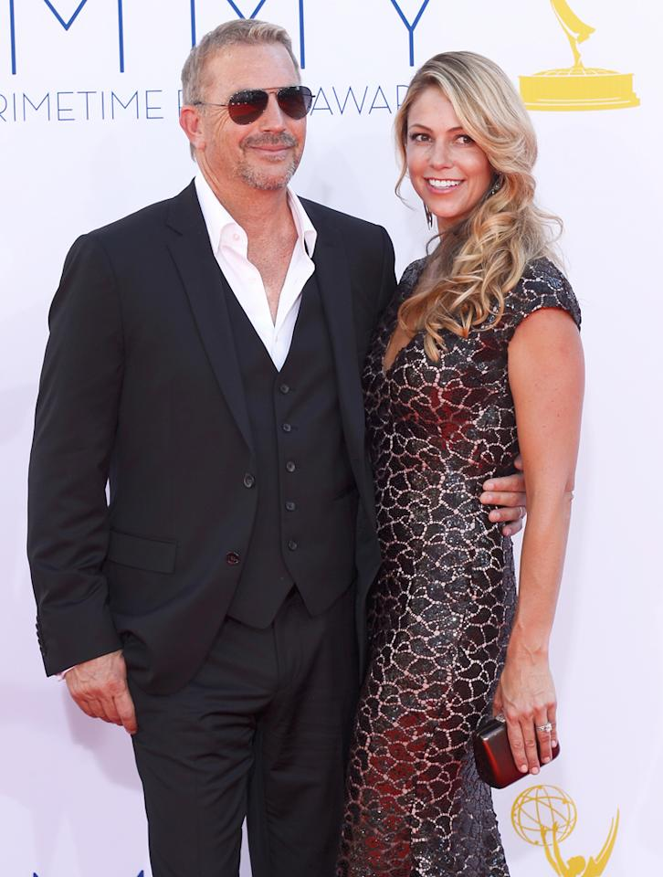 Kevin Costner and wife Christine Baumgartner arrive at the 64th Primetime Emmy Awards at the Nokia Theatre in Los Angeles on September 23, 2012.