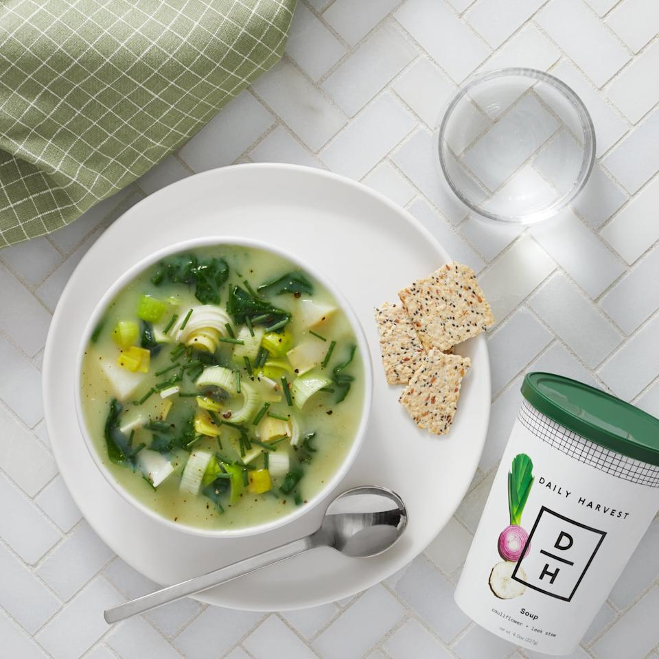 """<p>In 2020, I'm saying """"so long!"""" to $15-lunches that only taste """"meh."""" In an effort to save money while still fueling my body with needed nutrition, I'm investing in a build-your-own Daily Harvest meal plan. The <a href=""""https://www.popsugar.com/buy/Daily-Harvest-9-Cup-Weekly-Plan-540754?p_name=Daily%20Harvest%209-Cup%20Weekly%20Plan&retailer=daily-harvest.com&pid=540754&price=70&evar1=fit%3Aus&evar9=47114257&evar98=https%3A%2F%2Fwww.popsugar.com%2Fphoto-gallery%2F47114257%2Fimage%2F47114258%2FDaily-Harvest-Meals&prop13=api&pdata=1"""" rel=""""nofollow"""" data-shoppable-link=""""1"""" target=""""_blank"""" class=""""ga-track"""" data-ga-category=""""Related"""" data-ga-label=""""https://www.daily-harvest.com/app/browse/soups"""" data-ga-action=""""In-Line Links"""">Daily Harvest 9-Cup Weekly Plan</a> ($70 for nine cups per week) allows you to choose from healthy, pre-portioned smoothies, harvest bowls, soups, bites, oat bowls, chia bowls, and even lattes.</p>"""