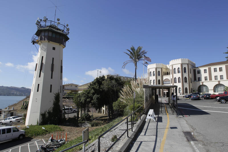 FILE - In this Sept. 21, 2010 file photo is the main entrance way to San Quentin State Prison where the state's death row is located in San Quentin, Calif. Seven years after Scott Peterson was sentenced to death for murdering his pregnant wife Laci, his appeal is moving at lightning speed, at least compared to those of his 725 fellow California Death Row inmates. Appealing the death penalty in California can take two decades, meaning that condemned prisoners are more likely to die behind bars of natural causes than be executed. Now voters in California get an opportunity this November to vote on a measure that would abolish the death penalty. (AP Photo/Eric Risberg, File)