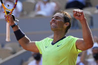 Spain's Rafael Nadal waves after defeating Argentina's Diego Schwartzman in their quarterfinal match of the French Open tennis tournament at the Roland Garros stadium Wednesday, June 9, 2021 in Paris. (AP Photo/Michel Euler)