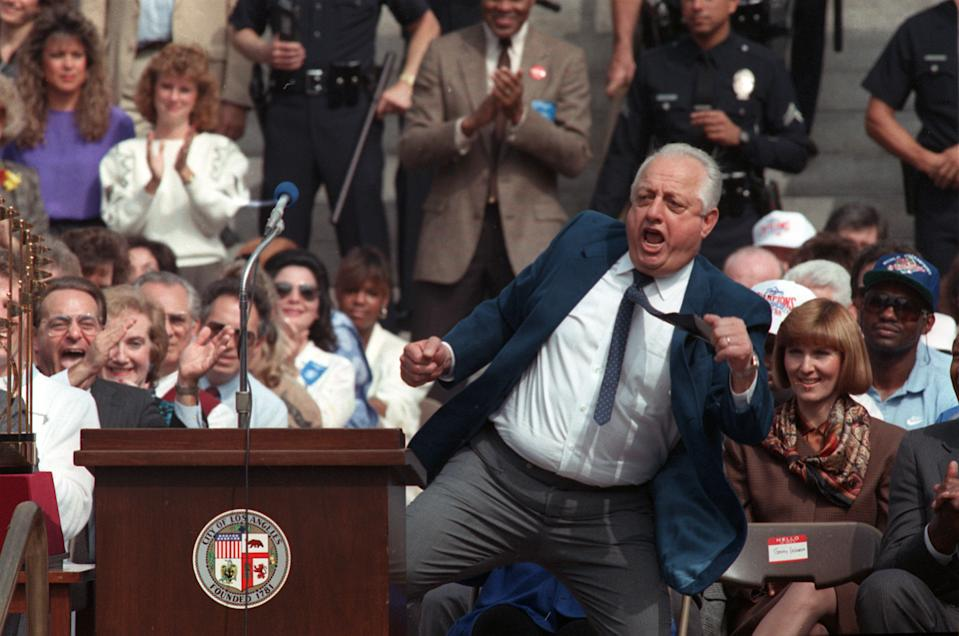 Tommy Lasorda dances for the team's fans during celebrations of their World Series win in downtown Los Angeles, CA, on Oct. 24, 1988. (AP Photo/Doug Pizac)