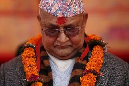 FILE PHOTO: Nepal's Prime Minister Khadga Prasad Sharma Oli, also known as K.P. Oli, observes a minute of silence for earthquake victims, in Bungamati village