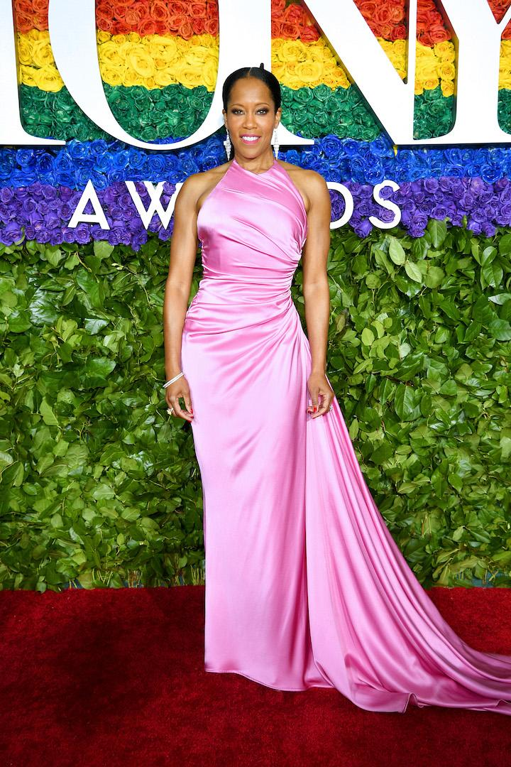 For the annual ceremony, Regina King looked pretty in pink courtesy of a Prada. Tony & Co. jewels finished the winning ensemble. <em>[Photo: Getty]</em>