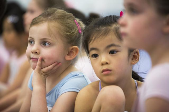 Children sit and wait for their turn during an audition for the School of American Ballet in New York April 25, 2014. The school is holding auditions for over 600 beginner ballet students, who will be selected to fill the 120 spots available to study on campus. REUTERS/Lucas Jackson (UNITED STATES - Tags: SOCIETY EDUCATION)