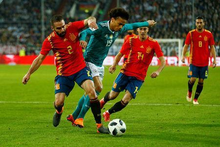 Soccer Football - International Friendly - Germany vs Spain - ESPRIT arena, Dusseldorf, Germany - March 23, 2018 Germany's Leroy Sane in action with Spain's Dani Carvajal and Lucas Vazquez REUTERS/Thilo Schmuelgen