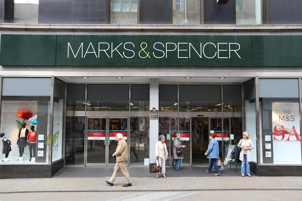 LEEDS, UK - JULY 12, 2016: People shop at Marks and Spencer department store in downtown Leeds, UK. M&S is a major retailer with 1,010 stores in 41 countries. It specializes in fashion and luxury goods.