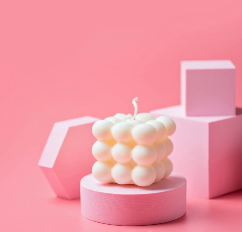 """<h3>Cube Bubble Candle</h3><br>If there's anything we've learned from the past year, it's that statement candles are in.<br><br><strong>All Things Shared</strong> Frameless Cloud-Shaped Mirror & Stand, $, available at <a href=""""https://amzn.to/3bERwJz"""" rel=""""nofollow noopener"""" target=""""_blank"""" data-ylk=""""slk:Amazon"""" class=""""link rapid-noclick-resp"""">Amazon</a>"""