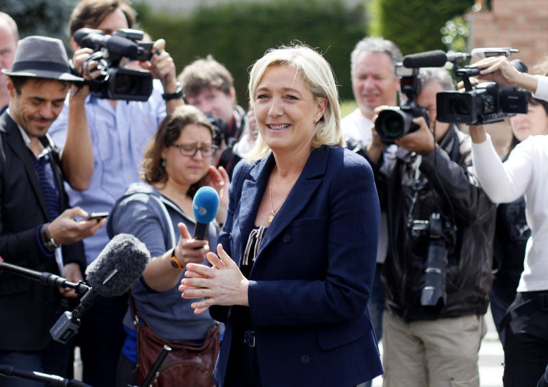 French far-right leader and National Front Party candidate for French legislative elections, Marine Le Pen is seen after voting for the second round of election, Sunday, June 17, 2012 in Henin-Beaumont, northern France. French Legislative elections determine the makeup of the new parliament. (AP Photo/Michel Spingler)