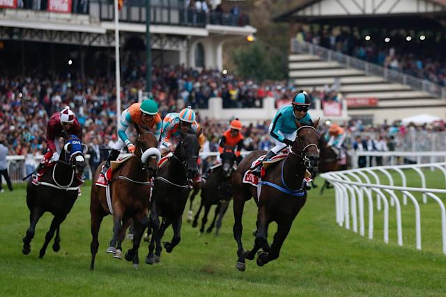 Chilean Horse Racing - Derby of Chile - Sporting Club of Vina del Mar Racecourse - February 4, 2018 Jockey Hector Berrios on Leitone(R) in action to win the 133st running of the Derby. REUTERS/Rodrigo Garrido