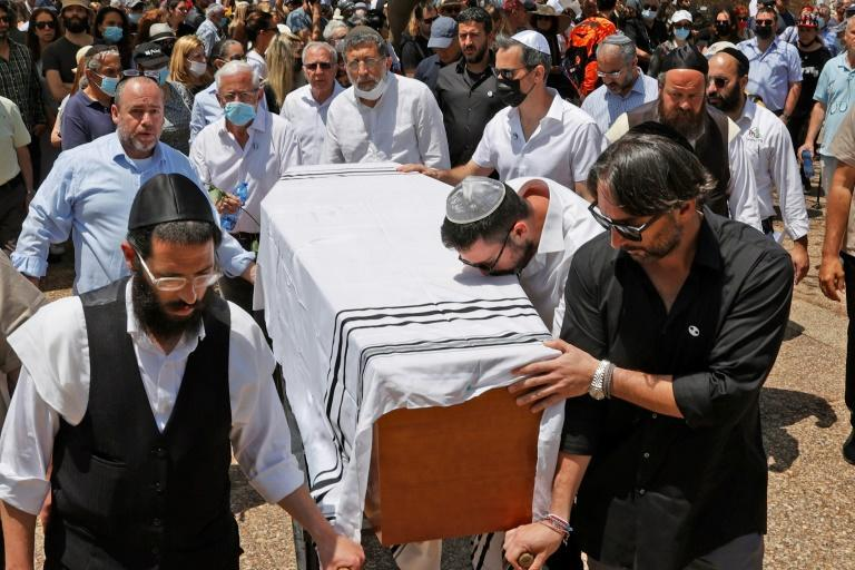 Relatives and friends carry the coffin of renowned Israeli-French fashion designer Alber Elbaz during his funeral in the Israeli city of Holon near Tel Aviv, on April 28, 2021