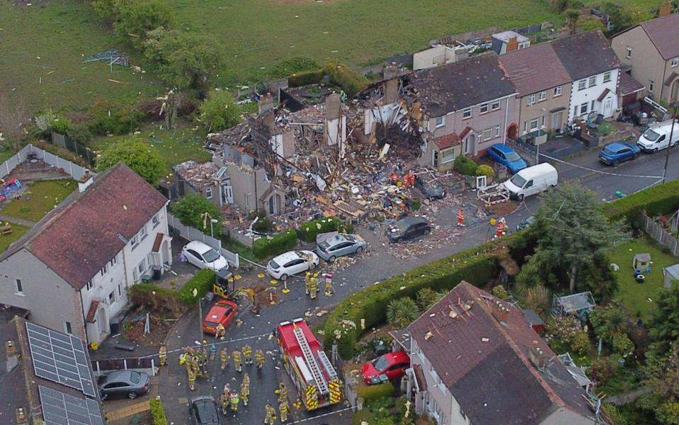 A child was killed and four adults injured after a suspected gas explosion ripped through three homes in the middle of the night - Mirrorpix