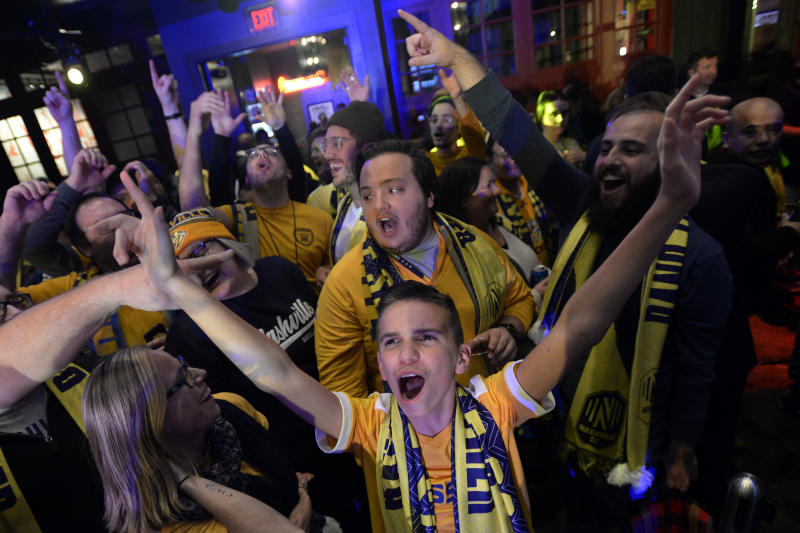 FILE - In this Nov. 19, 2019, file photo, Nashville SC fans cheer after the player selections were finished by the team's management in the Major League Soccer expansion draft Tuesday, in Nashville, Tenn. Nashville SC opens their inaugural MLS season on Saturday.  (AP Photo/Mark Zaleski, File)