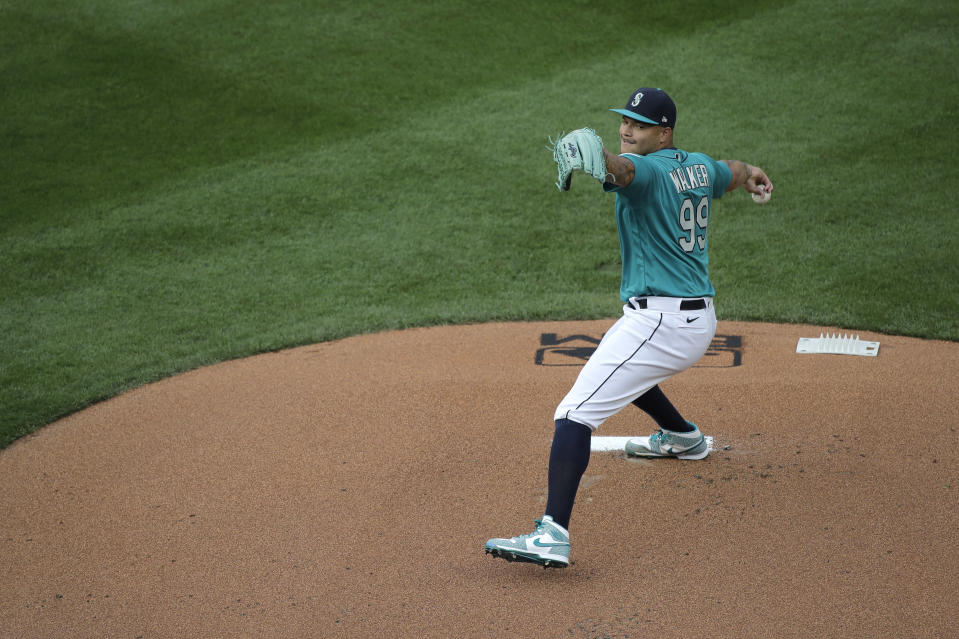 Seattle Mariners starting pitcher Taijuan Walker throws against the Oakland Athletics during the first inning of a baseball game, Friday, July 31, 2020, in Seattle. (AP Photo/Ted S. Warren)