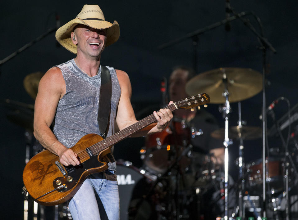 FILE - In this April 3, 2016, file photo, Kenny Chesney performs at the 4th Annual ACM Party for a Cause Festival in Las Vegas. Chesney's No Shoes Reefs organization is helping to have an artificial reef installed off of Florida's Atlantic Coast. The organization and other marine groups donated and installed 13 reef balls on the ocean floor off of Delray Beach in Palm Beach County. (Photo by Eric Jamison/Invision/AP, File)