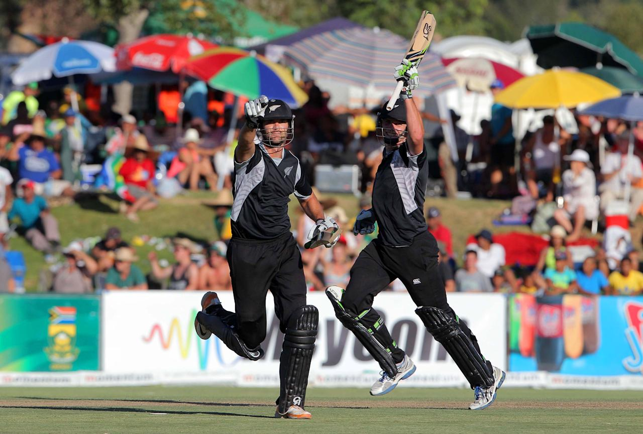 PAARL, SOUTH AFRICA - JANUARY 19: James Franklin (L) of New Zealand celebrates hitting the winning runs next to Mitchell McClenaghan during the 1st One Day International match between South Africa and New Zealand at Boland Park on January 19, 2013 in Paarl, South Africa.  (Photo by Carl Fourie/Gallo Images/Getty Images)