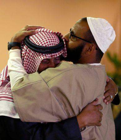 A freed Yemeni detainee (R) is hugged after his arrival at King Khalid International Airport in Riyadh, Saudi Arabia, January 5, 2017. REUTERS/Faisal Al Nasser