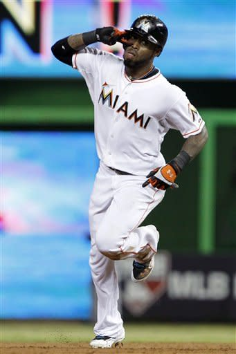 Miami Marlins' Jose Reyes (7) celebrates as he rounds second base after hitting a home run during the second inning of a baseball game against the Atlanta Braves, Tuesday, July 24, 2012, in Miami. (AP Photo/Wilfredo Lee)