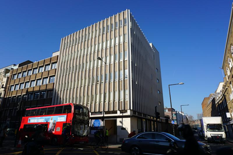 "In this photo taken on Tuesday, Feb. 26, 2019, a double-decker bus passes by the six-story London office building alleged to be the home of KWE Consulting, the company supposedly employing Victor Petrov. Neither Petrov nor his firm appear to exist; the AP found no evidence that either ever occupied the building. And newly filed court documents say that Petrov ""bears a striking similarity"" to Aharon Almog-Assouline, a spy surprised by the AP at a New York hotel restaurant in January. (AP Photo/Raphael Satter)"