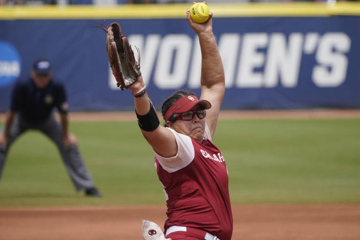 Oklahoma's Giselle Juarez pitches in the first inning of an NCAA Women's College World Series softball game against James Madison, Monday, June 7, 2021, in Oklahoma City. (AP Photo/Sue Ogrocki)