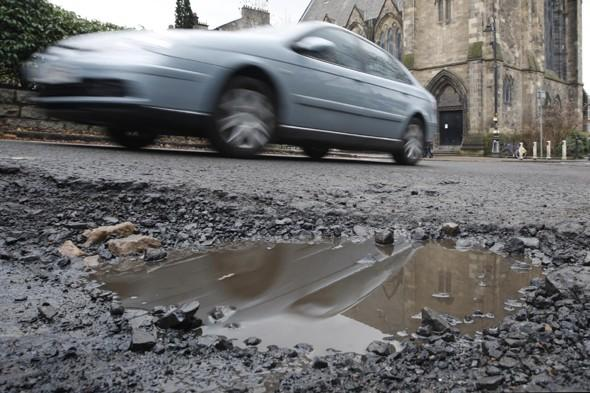 Wet winter causes Britain's roads to collapse