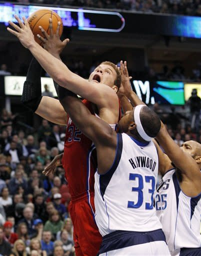 Los Angeles Clippers power forward Blake Griffin (32) shoots on Dallas Mavericks center Brendan Haywood (33) and Vince Carter (25) during the second half of an NBA basketball game in Dallas, Monday, Feb. 13, 2012. The Mavericks won 96-92. (AP Photo/LM Otero)