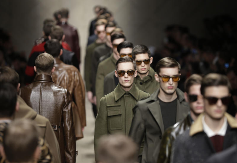 Models wear creations of Burberry Prorsum men's Fall-Winter 2013-14 collection, part of the Milan Fashion Week, unveiled in Milan, Italy, Saturday, Jan. 12, 2013.(AP Photo/Luca Bruno)