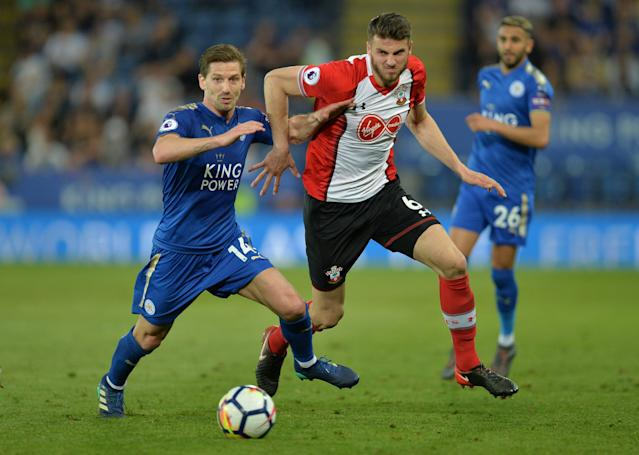 """Soccer Football - Premier League - Leicester City vs Southampton - King Power Stadium, Leicester, Britain - April 19, 2018 Leicester City's Adrien Silva in action with Southampton's Wesley Hoedt REUTERS/Peter Powell EDITORIAL USE ONLY. No use with unauthorized audio, video, data, fixture lists, club/league logos or """"live"""" services. Online in-match use limited to 75 images, no video emulation. No use in betting, games or single club/league/player publications. Please contact your account representative for further details."""