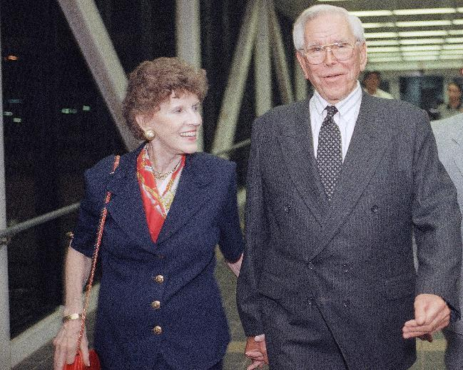 "FILE - In this Aug. 13, 1997, file photo, Rev. Robert Schuller , right, leaves Los Angeles International Airport with his wife Arvella. Arvella Schuller, who helped her pastor husband found the Crystal Cathedral megachurch and hallmark ""Hour of Power"" televangelism program died on Tuesday Feb. 11, 2014. She was 84. (AP Photo/John Hayes, File)"